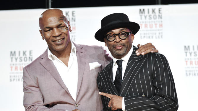 """Former heavyweight boxer Mike Tyson, left, and director Spiken Lee announce """"Mike Tyson: Undisputed Truth"""", a one man show on Broadway starring Mike Tyson, on Monday June 18, 2012 in New York. (Photo by Evan Agostini/Invision)"""