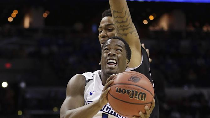 Creighton's Austin Chatman (1) drives past Creighton's Isaiah Zierden (21) during the first half of a second-round game in the NCAA college basketball tournament Friday, March 21, 2014, in San Antonio