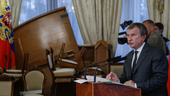 CEO of state-controlled Russian oil company Rosneft Igor Sechin speaks to press at the Novo-Ogaryovo residence outside Moscow, Russia on Monday, Oct. 22, 2012. Russian state-owned oil giant Rosneft strengthened its hold on the country's lucrative oil industry when it sealed a $61 billion deal, buying TNK-BP, the joint venture between a group of Russian oil oligarchs and the British energy company. (AP Photo/Sergey Ponomarev, Pool)
