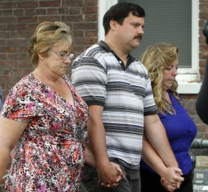 Jim Bennett, center, father of Brooke Bennett, walks with supporters following a plea hearing on Tuesday, Aug. 27, 2013, in Burlington, Vt. Michael Jacques, 47, of Randolph, Vt., pleaded guilty Tuesday to kidnapping, sexually assaulting and killing Brooke Bennet, his 12-year-old niece five years ago, avoiding a federal death penalty trial. Vermont has no state death penalty, but Jacques was to be tried under federal law. Jacques entered the plea in U.S. District Court in Burlington. As part of an agreement with federal prosecutors, he will be sentenced to life in prison without the possibility of parole. (AP Photo/Toby Talbot)