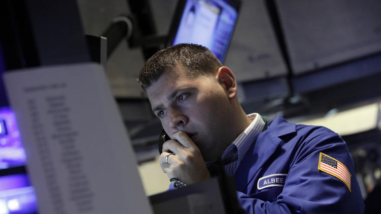 A specialist works on the floor of the New York Stock Exchange Friday, Sept. 7, 2012. Stocks are opening mixed on Wall Street following news that the U.S. economy added fewer jobs than expected in August. (AP Photo/Richard Drew)