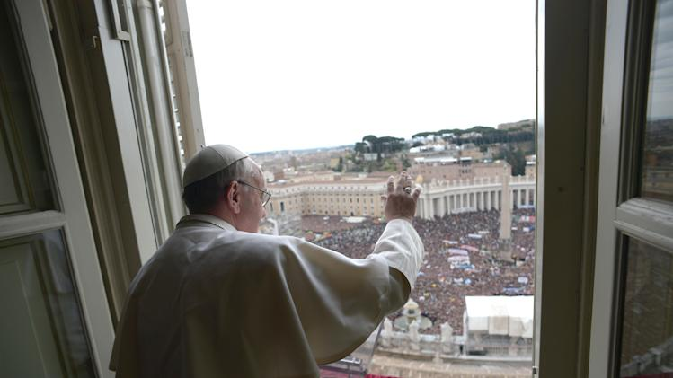 "In this photo provided by the Vatican paper L'Osservatore Romano, Pope Francis delivers his Angelus prayer from the window of his studio overlooking St. Peter's Square, at the Vatican, Sunday, March 17, 2013. Breaking with tradition, Pope Francis delivered off-the-cuff remarks about God's power to forgive instead of reading from a written speech for the first Sunday window appearance of his papacy. He also spoke only in Italian, beginning with ""buon giorno"" (Good day) and ending with ""buon pranzo"" (Have a good lunch), instead of greeting the faithful in several languages as his last few predecessors had done. (AP Photo/L'Osservatore Romano)"