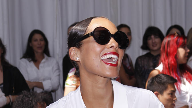 Singer Alicia Keys arrives for the Edun Spring 2013 collection show during Fashion Week, Saturday, Sept. 8, 2012, in New York. (AP Photo/Jason DeCrow)