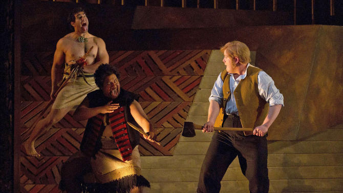 "In this March 13, 2012 photo provided by New Zealand Opera, Nicky Spence, right, as Thomas Mason/Caver and Jonathan Lemalu, center, as Te Kumete/Blackie and Phillip Rhodes, left, as Hohepa perform a scene from ""Hohepa"" at the Opera House in Wellington, New Zealand. Based on a true story spanning nearly 150 years, ""Hohepa"" lays bare some of New Zealand's most painful wounds - and seeks to heal them through music. The opera, given its world premiere Thursday, March 15, 2012 as part of this year's New Zealand International Arts Festival, is the creation of composer Jenny McLeod, who wrote both music and text (part English, part Maori). (AP Photo/New Zealand Opera, Marty Melville) EDITORIAL USE ONLY"
