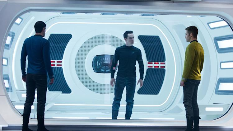 "This undated publicity film image released by Paramount Pictures shows, from left, Zachary Quinto, as Spock, Benedict Cumberbatch as John Harrison, and Chris Pine as Kirk, in a scene in the film, ""Star Trek: Into Darkness,"" from Paramount Pictures and Skydance Productions.  (AP Photo/Paramount Pictures, Zade Rosenthal)"