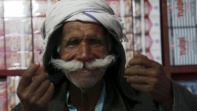 A cigarette salesman shows his mustache at the shrine of the Muslim Sufi poet Shah Abdul Latif in Bhit Shah