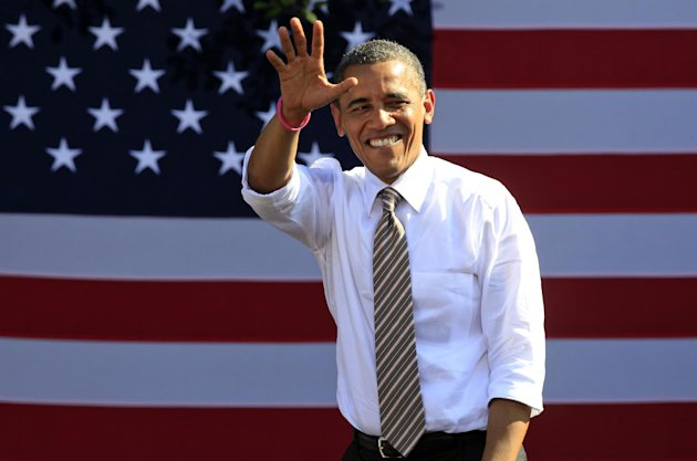 President Barack Obama waves to supporters during a campaign rally in Byrd Park in Richmond, Va., Thursday, Oct. 25, 2012. The president is on the second day of his 48 hour, 8 State campaign blitz. (AP Photo/Steve Helber)