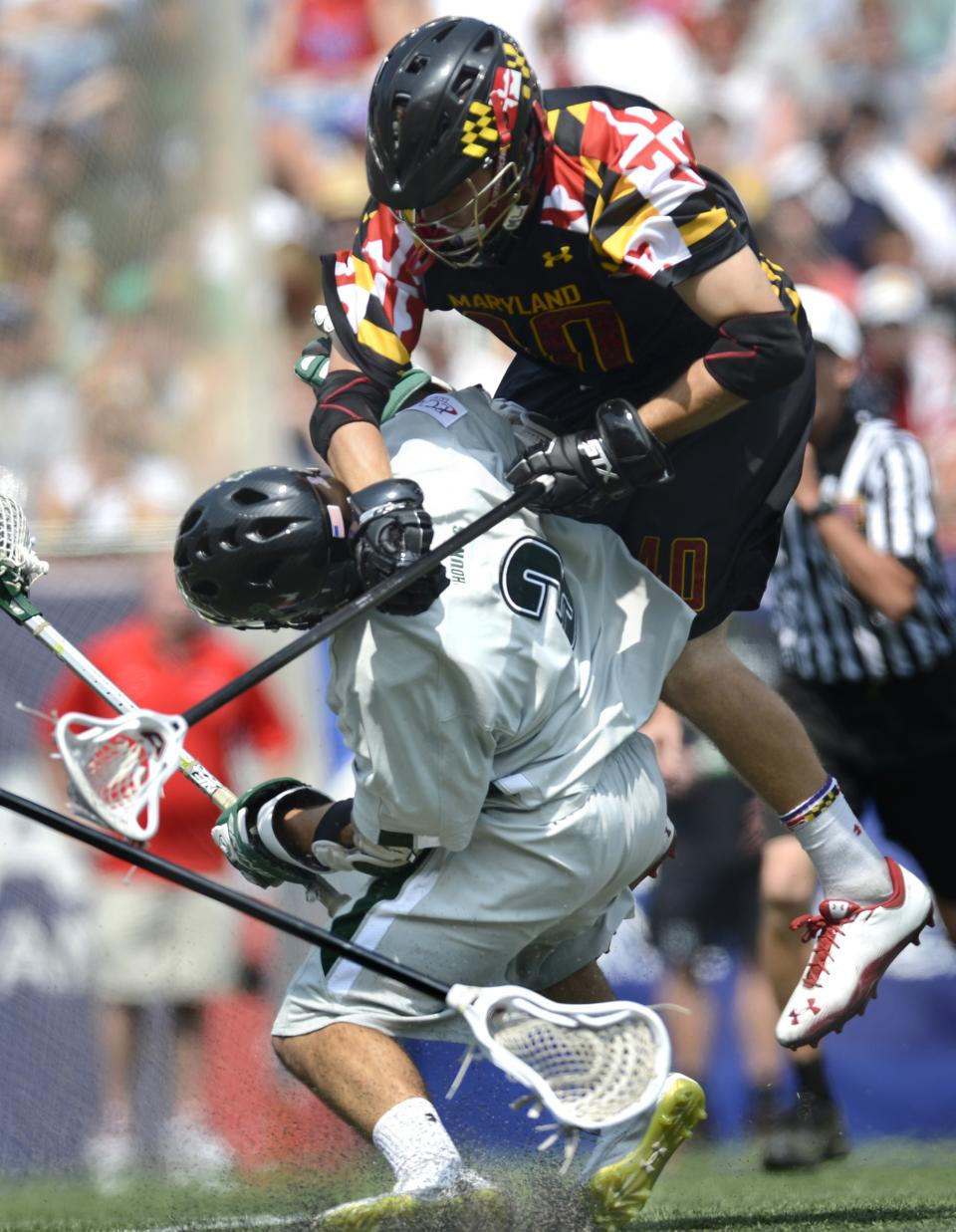 Maryland's Brian Cooper comes crashing down on Loyola's Chris Layne during the fourth quarter of their Division I NCAA men's lacrosse championship game at Gillette Stadium in Foxborough, Mass., Monday, May 28, 2012. Loyola won 9-3. (AP Photo/Gretchen Ertl)
