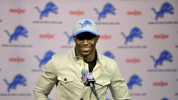 Reggie Bush speaks at a news conference after agreeing to a four-year deal with the Detroit Lions NFL football team, Wednesday, March 13, 2013 in Detroit.  (AP Photo/Detroit News, John T. Greilick)  DETROIT FREE PRESS OUT; HUFFINGTON POST OUT