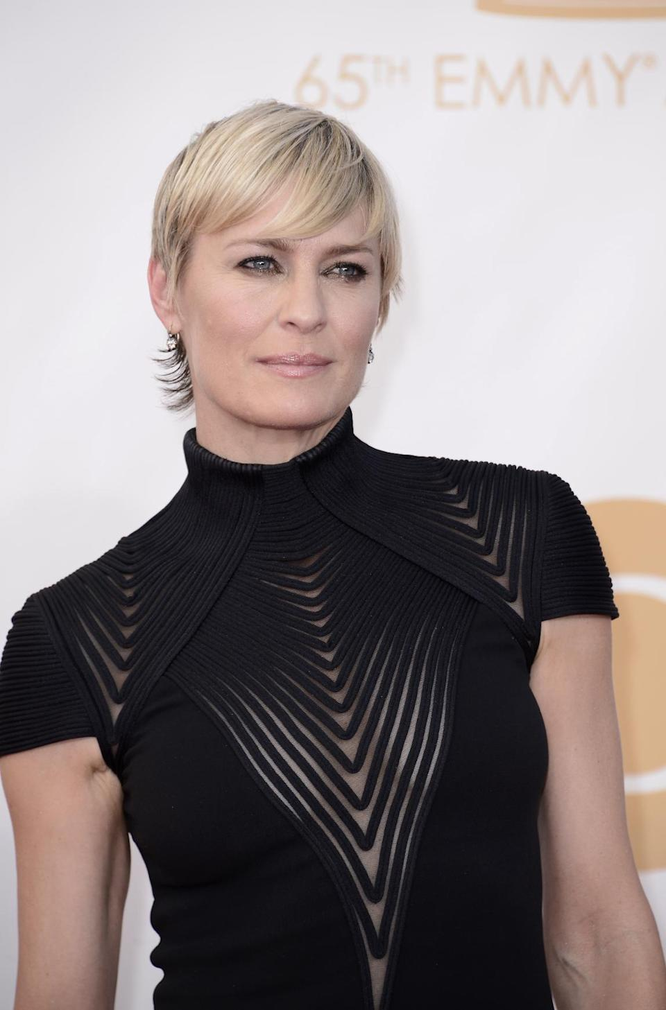 Robin Wright, wearing Ralph Lauren, arrives at the 65th Primetime Emmy Awards at Nokia Theatre on Sunday Sept. 22, 2013, in Los Angeles. (Photo by Dan Steinberg/Invision/AP)