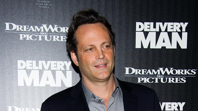 "FILE - This Nov. 17, 2013 file photo shows Vince Vaughn at a screening of ""Delivery Man"" hosted by The Cinema Society and DreamWorks Pictures in New York. In the new movie ""Delivery Man,"" Vince Vaughn plays a sperm donor who learns he's fathered more than 500 kids. In the past, that kind of scenario might have been the set up for film with adult humor, given the actor's portfolio. But ""Delivery Man"" is decidedly family-friendly fare, and reflects the stage of life where the 43-year-old married father of two finds himself these days. (Photo by Charles Sykes/Invision/AP, File)"