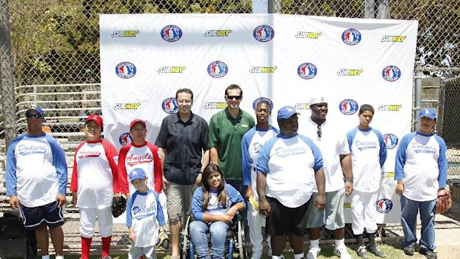 "COMMERCIAL IMAGE - Jared ""the SUBWAY guy"" and baseball All-Star Aaron Boone coach the SUBWAY National Little League Appreciation Game for the Challenger Division as they launch the national ""Buddy Badge"" program on Wednesday, June 27, 2012 in Los Angeles. (Photo by Joe Kohen/Invision for Subway/AP Images)"