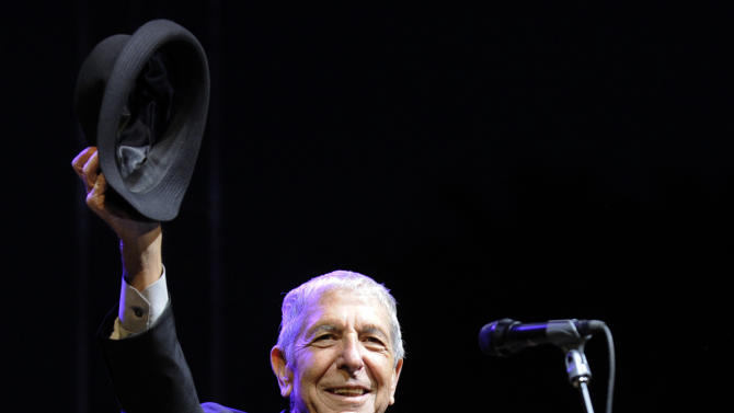 """FILE - In this April 17, 2009 file photo, Leonard Cohen salutes the crowd during his performance on the first day of the Coachella Valley Music & Arts Festival in Indio, Calif. It's hard to think of any song that has taken a stranger journey through popular culture than Leonard Cohen's """"Hallelujah."""" Author Alan Light's book, """"The Holy or the Broken,"""" releasing on Dec. 4, 2012, is about the trajectory of the song, """"Hallelujah,"""" and about Cohen and its most celebrated singer, the late Jeff Buckley. (AP Photo/Chris Pizzello, File)"""