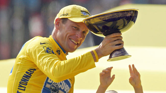 FILE - In this July 24, 2005 file photo, Luke Armstrong, rear right, tries to touch the winner's trophy held by his father, Lance Armstrong, after Armstrong won his seventh straight Tour de France cycling race, in Paris. During the second part Friday, Jan. 18,  2013, of Oprah Winfrey's interview with Armstrong, Armstrong talked about talking with Luke after his son had defended him concerning doping allegations.  (AP Photo/Peter Dejong, File)
