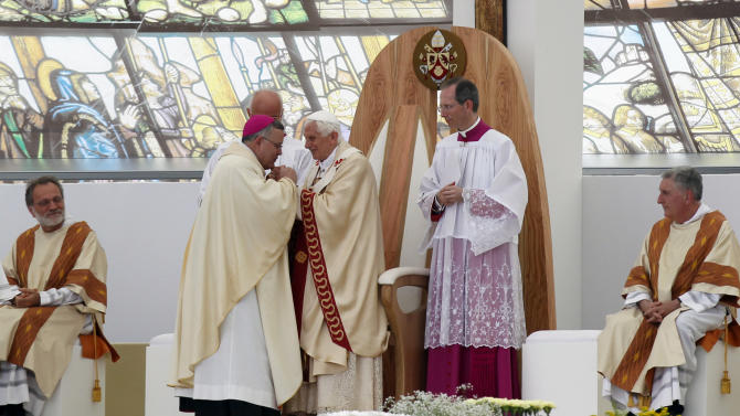 "CORRECT THAT ARCHBISHOP OF PHILADELPHIA IS 2ND LEFT   Pope Benedict XVI, centre, greets Archbishop of Philadelphia Charles Joseph Chaput, 2nd left,  as he celebrates a Mass in Bresso, near Milan, Italy, Sunday, June 3, 2012. Pope Benedict XVI has celebrated an open-air Mass before some 850,000 followers as part of three days of activities in Milan aimed at showing support for families. The pope in his homily Sunday took issue with modern economic thinking that he said ""creates ferocious competition, strong inequalities, degradation of the environment"" and reduces family relationships ""to fragile convergences of individual interests"" that undermine the social fabric. (AP Photo/Luca Bruno)"