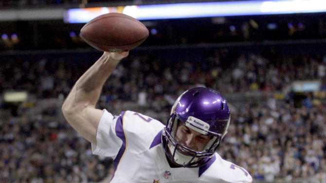 Minnesota Vikings quarterback Christian Ponder spikes the ball after scoring on a 5-yard run during the first quarter of an NFL football game against the St. Louis Rams Sunday, Dec. 16, 2012, in St. Louis. (AP Photo/Tom Gannam)
