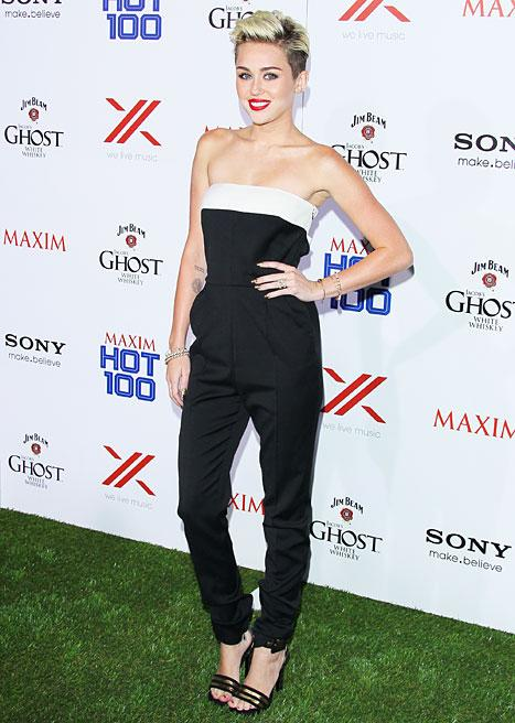 Miley Cyrus Wears Sexy Jumpsuit, Engagement Ring at Maxim Hot 100 Party