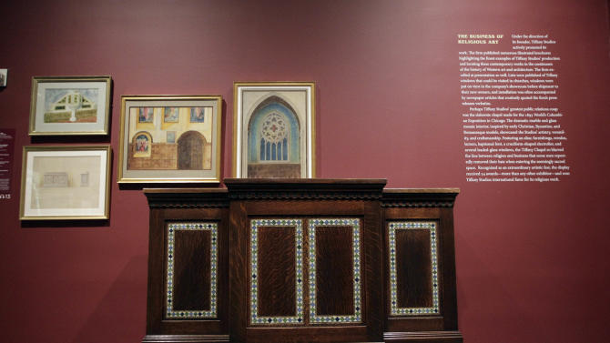"In this Thursday, Oct. 25 2012 photo, the Pulpit from South Presbyterian Church, Syracuse, N.Y., 1907, is on display at the ""Louis C. Tiffany and the Art of Devotion"" exhibit at the Museum of Biblical Art in New York.  (AP Photo/Mary Altaffer)"