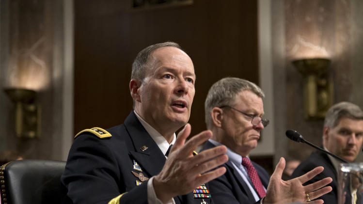 NSA director: Programs disrupted dozens of attacks