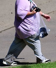Photo illustration shows an overweight male. In two randomized, controlled trials of around 3,700 obese and overweight patients followed for one year, the highest doses of Qsymia were associated with an average weight loss of between 6.7% and 8.9% over a sugar pill