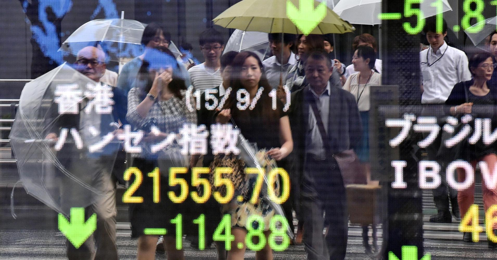 Asian shares mixed as Shanghai Comp fluctuates