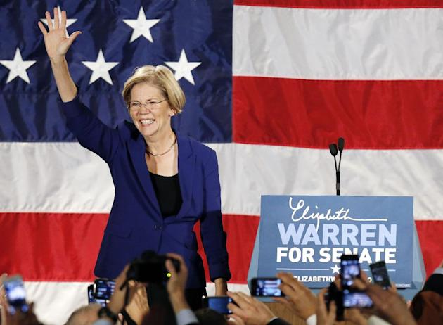 FILE - In this Nov. 6, 2012 file photo, Sen.-elect Elizabeth Warren, D-Mass. waves to the crowd before giving her victory speech, in Boston. (AP Photo/Michael Dwyer, File)