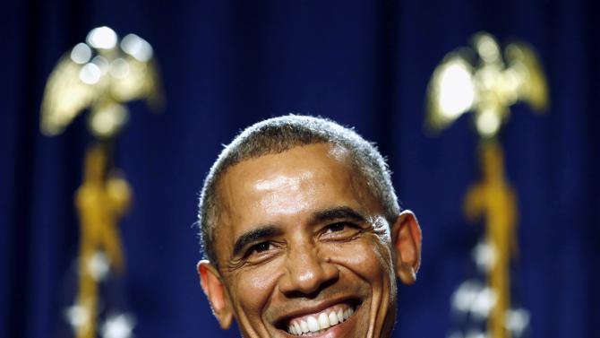 Obama smiles as he delivers remarks at the House Democratic Issues Conference in Pennsylvania
