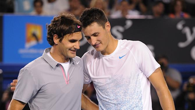 Switzerland's Roger Federer, left, is congratulated by Australia's Bernard Tomic following their third round match at the Australian Open tennis championship in Melbourne, Australia, Saturday, Jan. 19, 2013. (AP Photo/Andrew Brownbill)