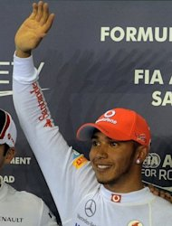 Lewis Hamilton of Britain waves after claiming his 5h pole position of the season at the Singapore Grand Prix on September 22. McLaren drivers Hamilton and Jenson Button were both enthusiastic about the American races