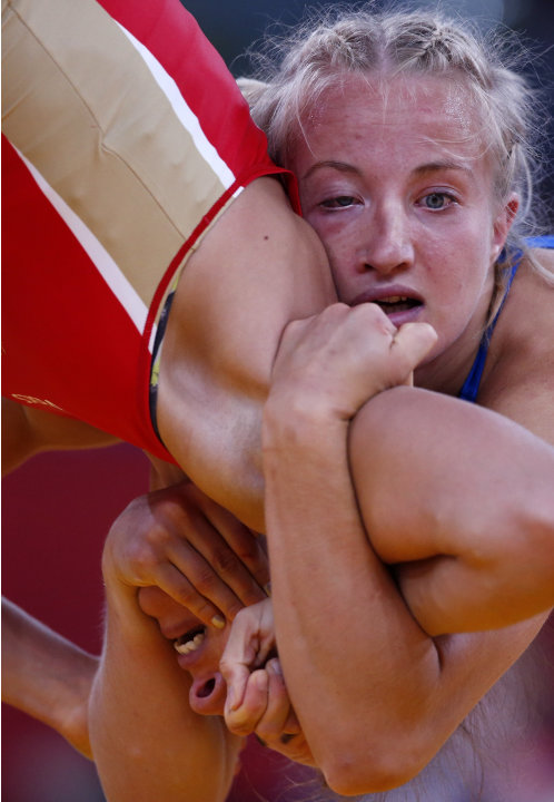 Sweden's Sofia Mattsson fights with Russia's Valeriia Zholobova on the Women's 55Kg Freestyle wrestling at the ExCel venue during the London 2012 Olympic Games