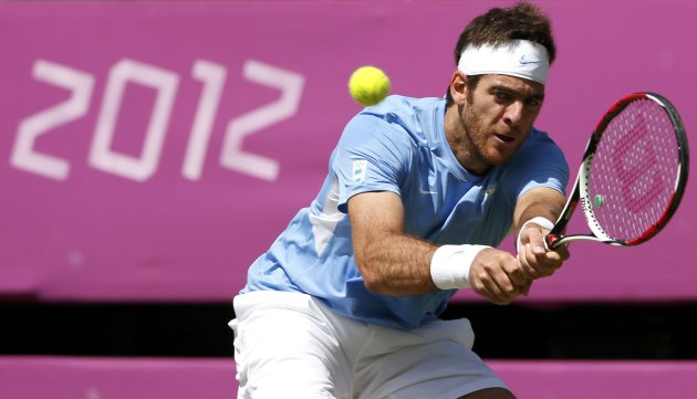 Argentina's Del Potro returns to Switzerland's Federer in their men's singles tennis semi-final match at the All England Lawn Tennis Club during the London 2012 Olympic Games