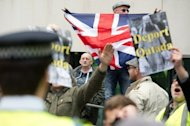 <p>Members of the English Defence League (EDL) demonstrate calling for the deportation of radical Islamist cleric Abu Qatada outside the Home Office in central London in April. British officials and media reacted with outrage after judges allowed Abu Qatada, dubbed Osama bin Laden's right-hand man in Europe, to go free on bail Tuesday</p>