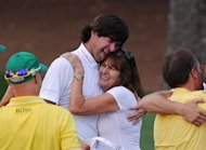 Bubba Watson of the US celebrates winning the 76th Masters golf tournament in a play-off against Louis Oosthuizen of South Africa with his mother Molly Watson at Augusta National Golf Club in Augusta, Georgia