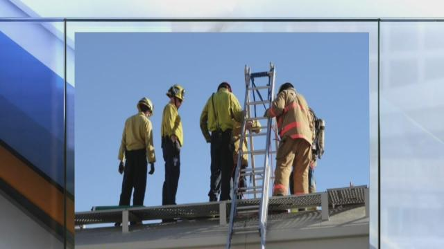 Man rescued from rail car