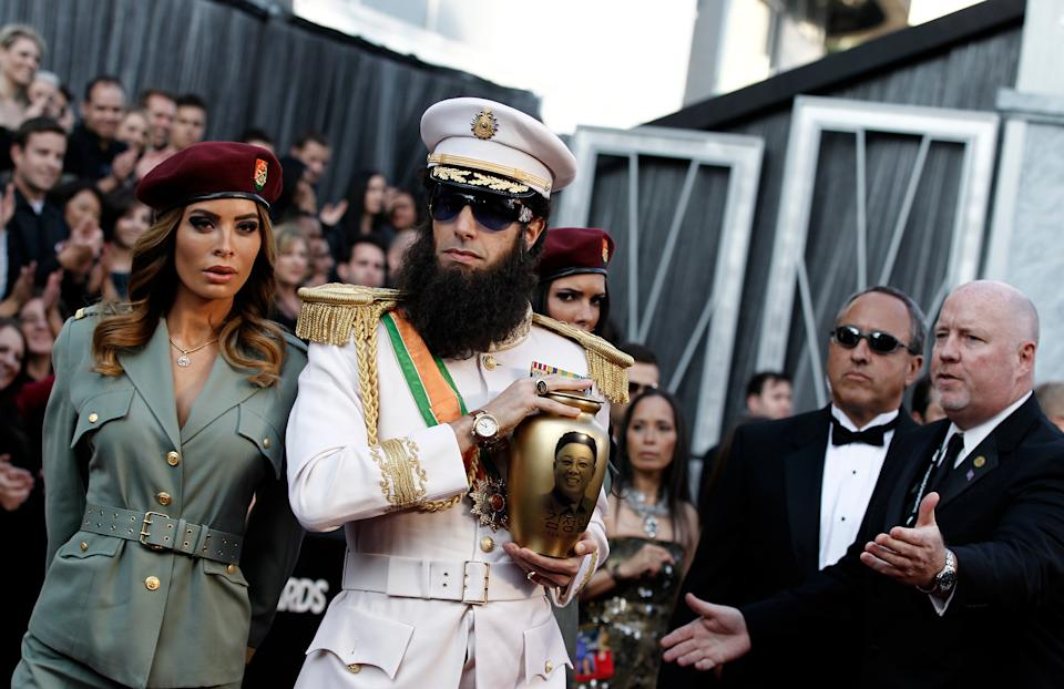 Sacha Baron Cohen, right, and guest arrive before the 84th Academy Awards on Sunday, Feb. 26, 2012, in the Hollywood section of Los Angeles. (AP Photo/Matt Sayles)