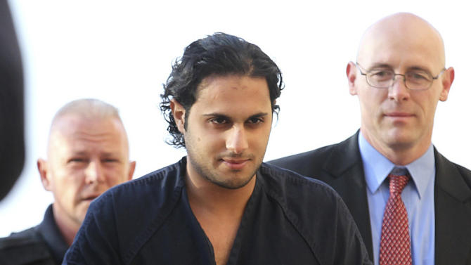 FILE - In this Feb. 25, 2011, file photo, Khalid Ali-M Aldawsari, accused of buying chemicals and equipment to build a weapon of mass destruction, is escorted to a court appearance in Lubbock, Texas. The former student from Saudi Arabia convicted in a failed U.S. bomb plot been given a life sentence Tuesday, Nov. 13, 2012 in Amarillo, where jurors convicted him in June of attempting to use a weapon of mass destruction.  (AP Photo/Lubbock Avalanche-Journal, Zach Long, File)