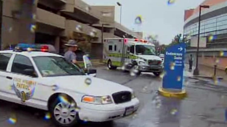 In this frame grab from video released by WEWS 5 in Cleveland, an Ohio State Highway Patrol car blocks the road as an ambulance carrying former President Jimmy Carter arrives at MetroHealth Hospital, Tuesday, Sept. 28, 2010, in Cleveland. Carter, on a trip promoting his new book, developed an upset stomach on a flight to Cleveland and was taken to the hospital for observation, officials said. (AP Photo/WEWS 5) MANDATORY CREDIT; NO SALES