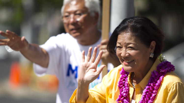 Congresswoman Mazie Hirono, D-Hawaii, right, does some last minute campaigning Saturday, Aug. 11, 2012 in Honolulu.  Hirono is running for the Democratic nomination for a Hawaii seat in the U.S. Senate.  Hawaii holds is primary election today.  (AP Photo/Marco Garcia)