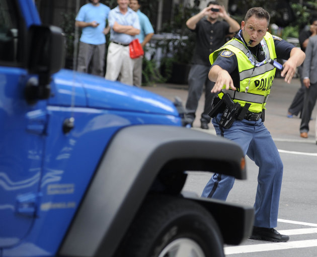 Clayton County (Ga.) Sheriff's Deputy John Strutko dances as he directs traffic Wednesday, Sept. 5, 2012, in Charlotte, N.C., during the second day of the Democratic National Convention. (AP Photo/Mik