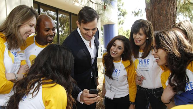 IMAGE DISTRIBUTED FOR INTUIT -  Bill Rancic interacts with Intuit employees at the company's first ever Hire Smart Small Business Event on Saturday, April, 27, 2013 in Mountain View, Calif. The event offered small business owners free resources and expert advice for hiring employees. (Photo by George Nikitin/Invision for Intuit/AP Images)