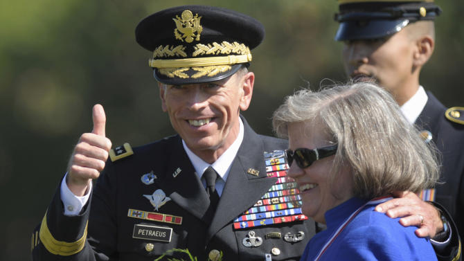 FILE - In this Aug. 31, 2011 file photo, former Commander of International Security Assistance Force and U.S. Forces-Afghanistan Gen. Davis Petraeus, standing with his wife Holly, participates in an armed forces farewell tribute and retirement ceremony at Joint Base Myer-Henderson Hall in Arlington, Va. Gen. Petraeus, the retired four-star general who led the U.S. military campaigns in Iraq and Afghanistan, resigned Friday, Nov. 9, 2012 as director of the CIA after admitting he had an extramarital affair. (AP Photo/Susan Walsh, File)