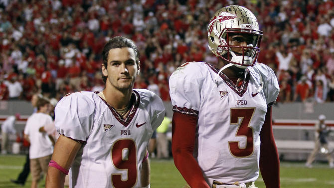 Florida State's Clint Trickett (9) and quarterback EJ Manuel (3) leave the field following Florida State's 17-16 loss to North Carolina State in an NCAA college football game in Raleigh, N.C., Saturday, Oct. 6, 2012. (AP Photo/Gerry Broome)