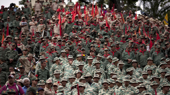 FILE - In this Jan. 10, 2013 file photo, members of Venezuela's Bolivarian militia attend the symbolic inauguration for President Hugo Chavez in Caracas, Venezuela.  Since taking office in 1999, Chavez has tried to transform the military into defenders of his socialist-inspired policies, especially since a 2002 coup led by rebellious soldiers, and has cultivated the 125,000 person-strong citizens militia. (AP Photo/Ariana Cubillos, File)