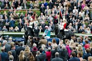 Jockey Tom Queally gestures to the crowd as he rides racehorse Frankel. Frankel bowed out with the cheers of 32,000 people ringing in his ears and the ultimate accolade from his legendary trainer Henry Cecil who claimed there had never been a greater racehorse