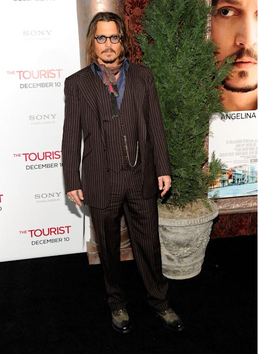 Depp in a pinstriped three-piece suit