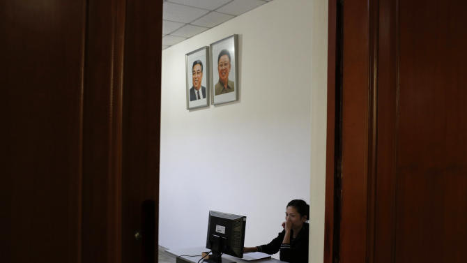 FILE - In this Sept. 20, 2012 file photo, a North Korean woman sits in a computer room near portraits of the country's late leaders, Kim Il Sung and Kim Jong Il, at the Kim Chaek University of Technology in Pyongyang, North Korea. Google's executive chairman Eric Schmidt is preparing to travel to one of the last frontiers of cyberspace: North Korea. Schmidt will be traveling to North Korea on a private trip led by former New Mexico Gov. Bill Richardson that could take place as early as this month, sources told The Associated Press on Wednesday, Jan. 2, 2013. The sources, two people familiar with the group's plans, asked not to be named because the visit had not been made public. (AP Photo/Vincent Yu, File)