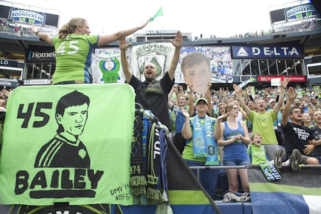 Seattle Sounders fans cheer for Seattle Sounders player Xander Bailey following a friendly soccer match against Tottenham Hotspur in Seattle, Saturday...