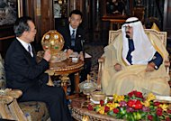 FILE - In this Jan. 15, 2012 file photo provided by Saudi Press Agency, Chinese Premier Wen Jiabao, left, meets with Saudi King Abdullah, right, in Riyadh, Saudi Arabia, during his six-day Mideast trip, which will also take him to the United Arab Emirates and Qatar. The Iranians have watched as frustrated bystanders while the leader of its most influential ally, China, has toured the Gulf Arab states with talks in Tehran's top regional rival Saudi Arabia. (AP Photo/Saudi Press Agency, File) EDITORIAL USE ONLY, NO SALES