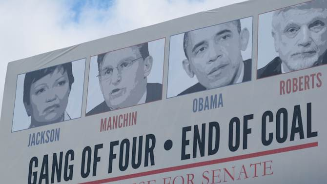 "Republican candidates are using the idea of a ""war on coal"" in their campaigns this year, as in this sign that targets incumbent Democratic U.S. Sen. Joe Manchin in Morgantown, W.Va., on Oct. 16, 2012.  Once, coal miners were literally at war with their employers. Today, their descendants are allies in a rhetorical war playing out across eastern Kentucky, southwestern Virginia and all of West Virginia. The message: They now face a common enemy, the federal government, especially the president and the Environmental Protection Agency.(AP Photo/Vicki Smith)"