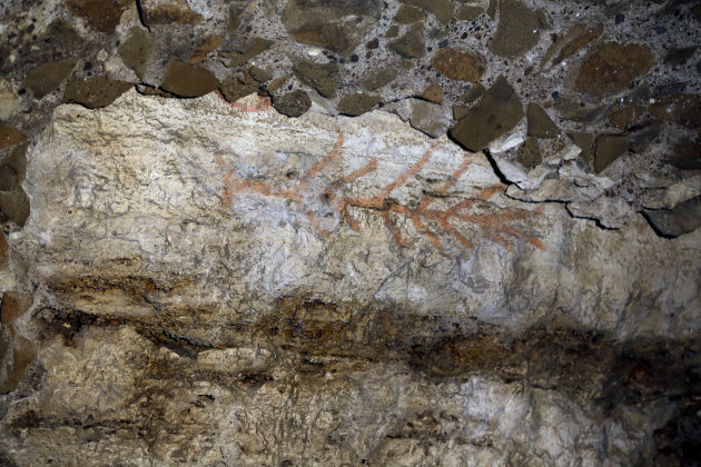 An ancient graffiti recently discovered during restoration works is seen inside a gallery of Rome's Colosseum, Friday, Jan. 18, 2013. A long-delayed restoration of the Colosseum's only intact internal
